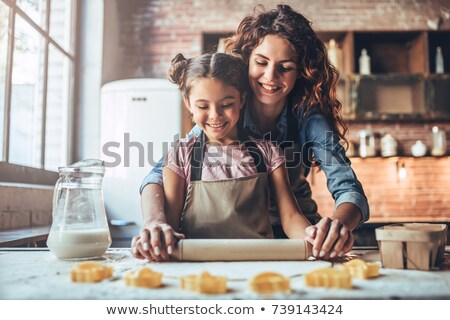 Mother baking with her daughter Stock photo © photography33