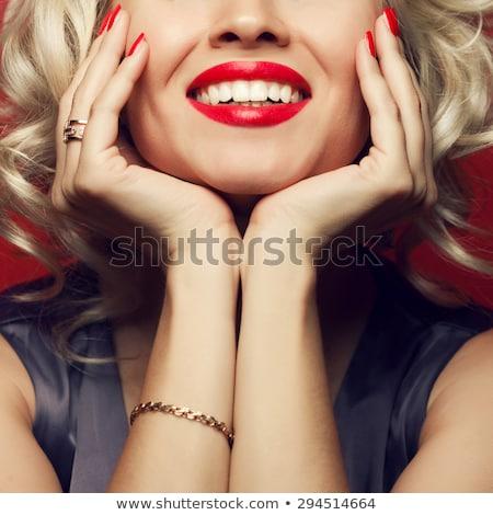Loiro mulher batom vermelho sorridente posando branco Foto stock © dash