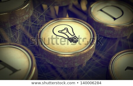 Lamp Bulb Typewriter Key. Grunge Background. Stock photo © tashatuvango