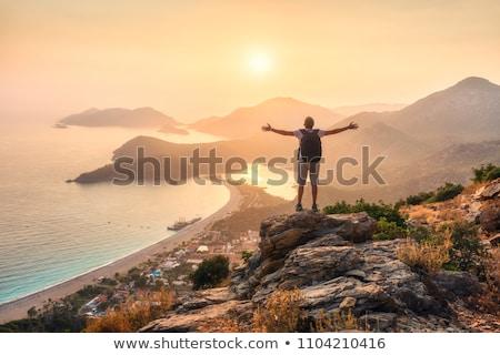 Nascer do sol mar montanhas alto sol pôr do sol Foto stock © thomaseder