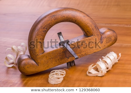 Old Router Plane With Shavings On A Cherry Wood Board Photo stock © Zerbor