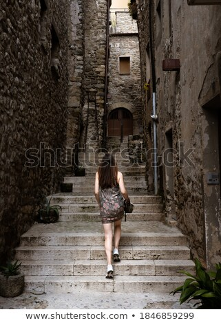 Tall and pretty young model walking in old town Stock photo © konradbak