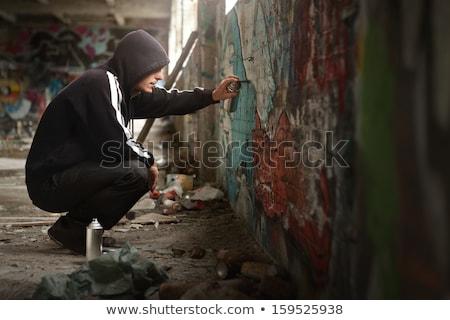 Graffiti művész copy space fiatalember rajz fal Stock fotó © stokkete