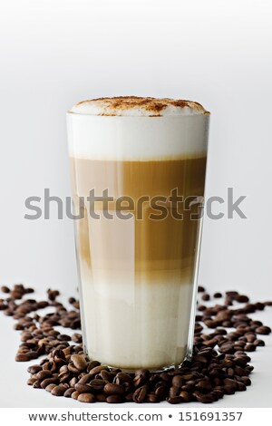 latte macchiato with chocolate powder coffee beans and cookies stock photo © rob_stark