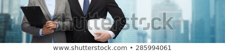 Businessman in a hardhat with a clipboard Stock photo © photography33
