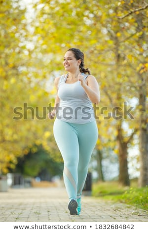 Young fit woman does running, jogging training Stock photo © photocreo