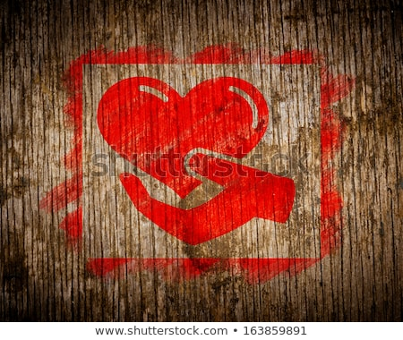 red charity concept painted by stencil on wood stock photo © tashatuvango