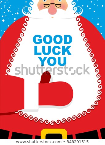 santa claus is wishing good luck and wink stock photo © marinini