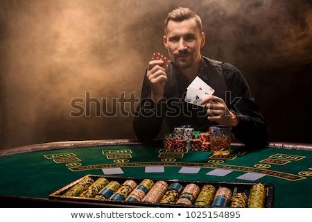 élégant poker joueur deux mains Photo stock © Nejron