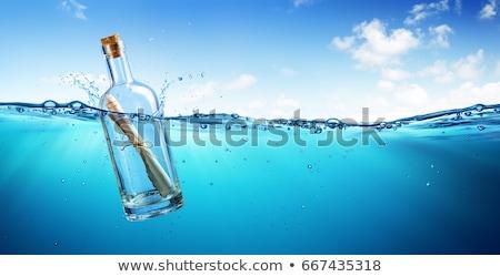 mensagem · garrafa · flutuante · oceano · verde · céu - foto stock © paulfleet