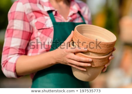 Two clay pots held by gardener close-up Stock photo © CandyboxPhoto
