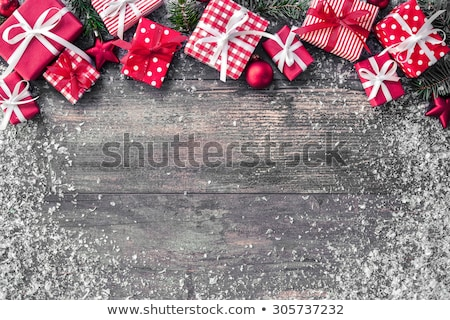 christmas presents and ornaments on wooden background stock photo © ani_dimi