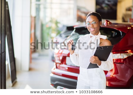 smiling woman sitting at the wheel of her new car stock photo © wavebreak_media