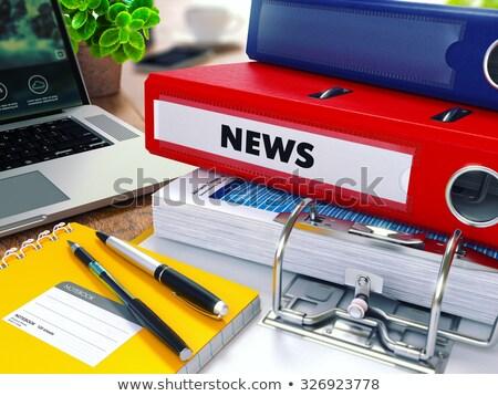 News on Red Ring Binder. Blurred, Toned Image. Stock photo © tashatuvango