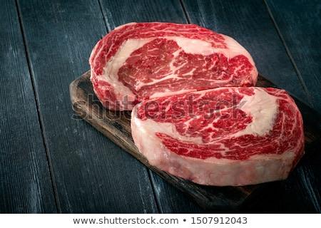Prime ribs raw on the board Stock photo © paulovilela