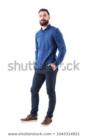 Przypadkowy młody człowiek denim shirt stwarzające ciemne Zdjęcia stock © feedough