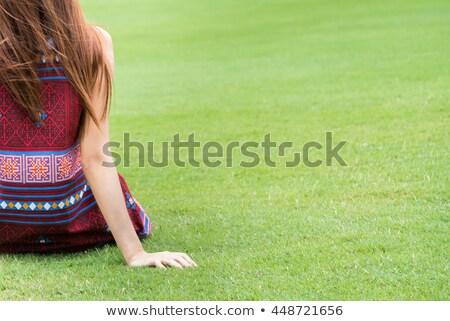 Stock photo: Faceless girls sitting back to back