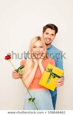 Romantic man surprising his date with a rose Stock photo © dash