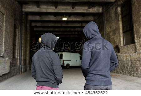addict men or criminals in hoodies on street Stock photo © dolgachov