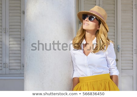 Beautiful blonde woman wearing a hat and sunglasses, enjoying th foto stock © Yatsenko