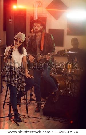 Teljes alakos zenész énekel éjszakai klub színpad zene Stock fotó © wavebreak_media