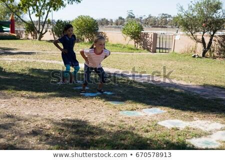 gyermek · nevet · ugrik · gyönyörű · mosolyog · aranyos - stock fotó © wavebreak_media