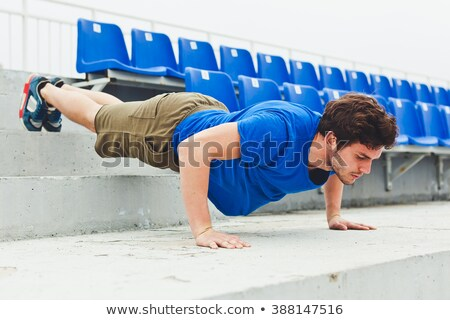 handsome young sports man at the stadium outdoors stock photo © deandrobot
