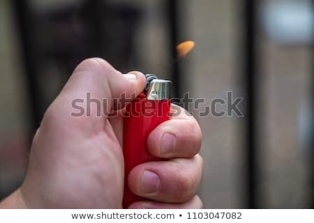 Kadın sigara çakmak eller genç Stok fotoğraf © deandrobot