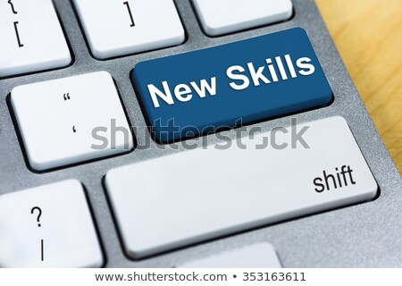 keyboard with blue button   new skills stock photo © tashatuvango