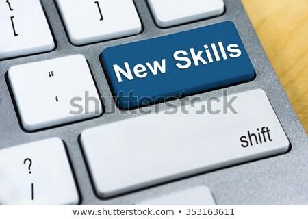 Teclado azul botão novo habilidades conceitos Foto stock © tashatuvango