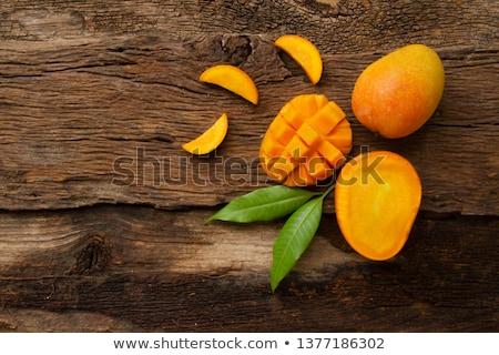 fresh mango on wood background Stock photo © M-studio