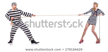 Pretty girl in prisoner uniform isolated on white Stock photo © Elnur