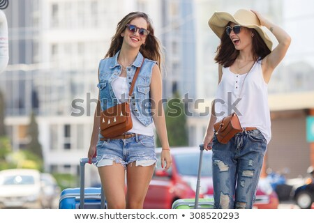 Two women walking to their car Stock photo © IS2