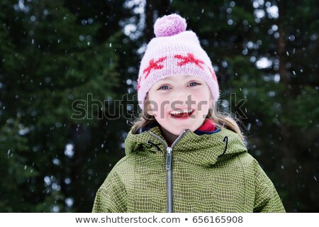 Young girl in wooly hat with snow flakes Stock photo © IS2