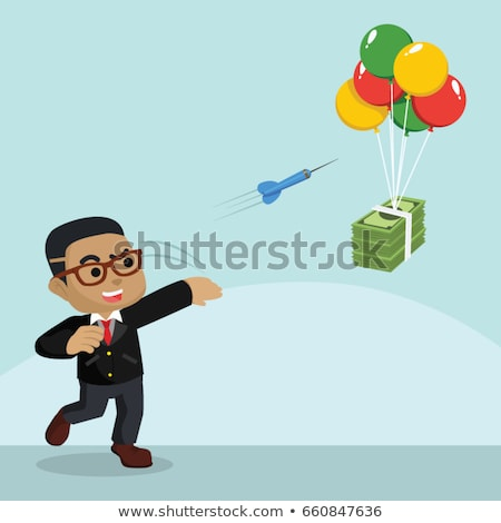 African businessman throwing money in the air Stock photo © studioworkstock