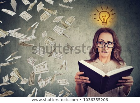 student reading a book has a bright idea how to earn money stock photo © ichiosea