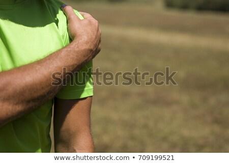 Yakışıklı adam omuz ağrısı eğitim doğa vücut sağlık Stok fotoğraf © boggy