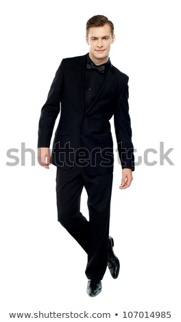 cool elegant man standing with legs crossed  Stock photo © feedough