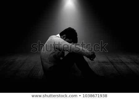 side view of seated businessman looking down to side Stock photo © feedough