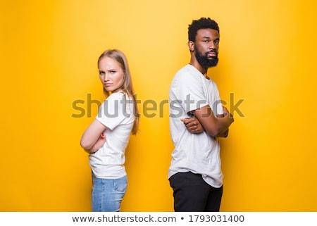 Brigar jovem bonitinho africano casal isolado Foto stock © deandrobot