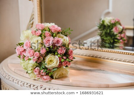 Bridal bouquet of roses on the luxury mirror table  stock photo © ruslanshramko