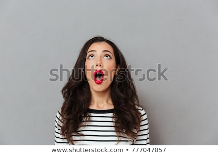 Shocked woman looking camera with opened mouth Stock photo © deandrobot