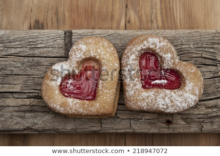 gingerbread heart cookie on wooden background stock photo © brebca