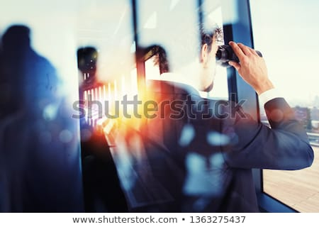 Businessman looks far for new business opportunities. Double exposure Stock photo © alphaspirit