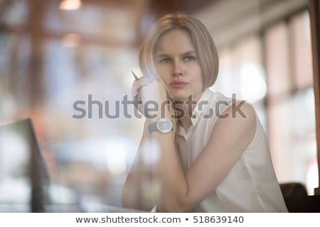 Image of tense concentrated woman studying, while sitting at des Stock photo © deandrobot
