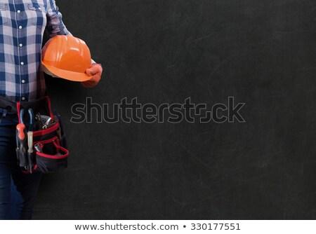 Stock photo: Builder on a dark background