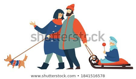 wintertime mother walking with kid on sledges stockfoto © robuart