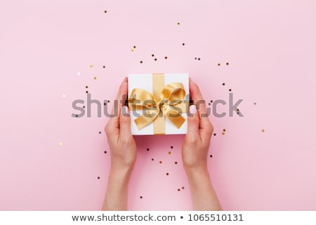 Woman's hands hold christmas or new year gift box. stock photo © AbstractVanilla