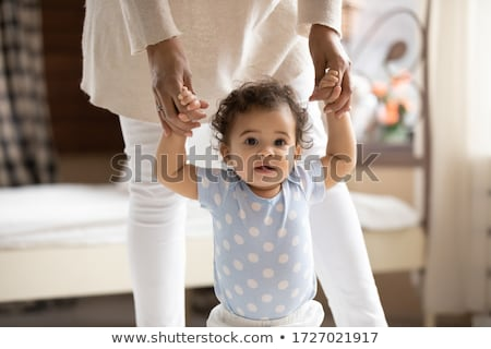 little baby girl first steps with the help of mother stock photo © lopolo