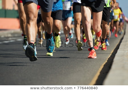 Courir concurrence jeunes athlète pantalon noir courir Photo stock © pressmaster